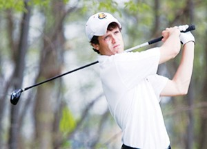 <span class='credit'>Photo Courtesy of Doug Witte, GVSU Photographer</span><span class='description'>Following Through: Senior Eric Lilleboe tees off in the Super Regional, which went on from May 4th to May 6th of this year.</span>