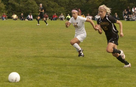 Winning Streak: FSU freshman forward Sam Kay pushes past an opponent during a 2011 game, while Mekyla Spraggins, senior defender, offers support. The Bulldogs are on a three-game winning streak following their victories against Ashland on Sept. 23 and Lake Erie on Sept. 25. Photo By: Kate Dupon   Photo Editor
