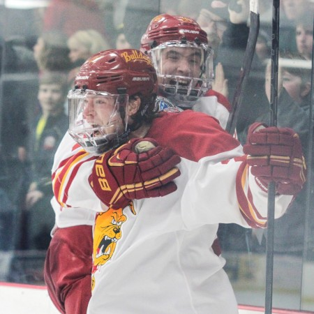 State of Elation: Ferris State captain Kyle Bonis screams in excitement while Simon Denis hops on his back after scoring the game-tying goal with less than a minute remaining in regulation.  Photo by Brock Copus   Multimedia Editor