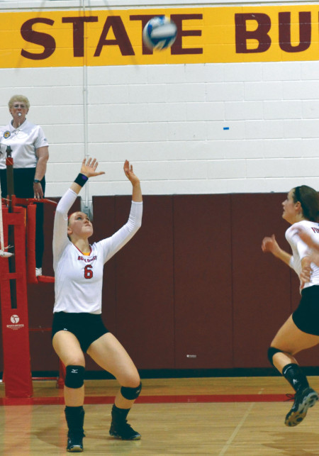 Freshman setter Stephanie Sikorski, setting up the ball for her teammate, has proven herself time and again as a key team player throughout the season as the starting setter for the women's volleyball team.  Torch File Photo