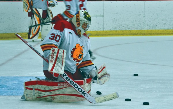 Motte makes a save during a warm up session in January, 2014