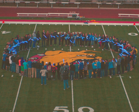 Students gather on Top Taggart field with blue lights in hand to show their support during Autism Awareness month. Photo By: Tori Thomas | Photographer