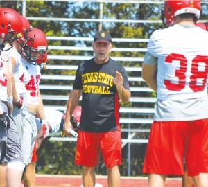 Head coach Tony Annese walks team through one of many pre-season practices as Ferris State prepares for upcoming 2014 football season.
