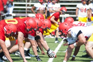 Offensive and defensive linemen from Ferris State's football team line up prior to the 2013 GLIAC football season. Concussions have become football's hot button issue that isn't going away.