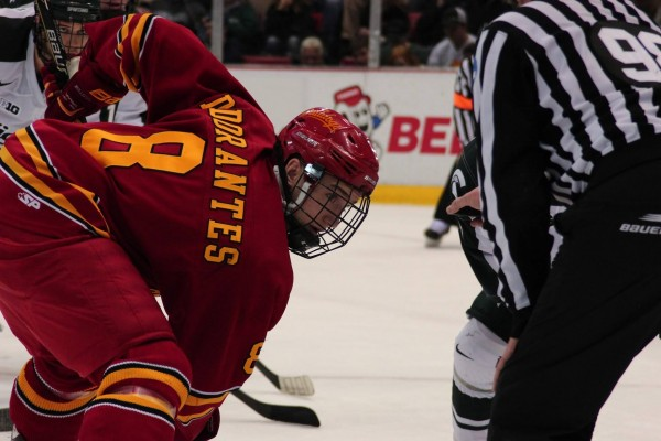 Freshman forward Drew Dorantes leans in for a face-off against Michigan State.