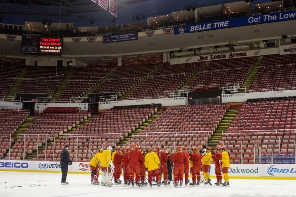 Ferris huddles around head coach Bob Daniels at practice on Sunday, December 28.