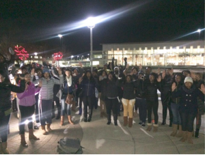 Members of the Black Student Union with their hands up at the Eric Garner Rally held on campus.