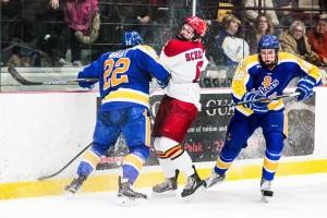 Sophomore forward Kyle Schempp battles against Lake Superior State.