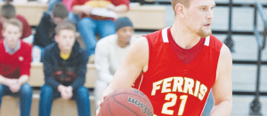 Bulldog #21, Drew Lehman tears up the court earlier this season against Tiffin. Lehman is the team leader in points, and recently scored his 1,000th career point as a Dawg.