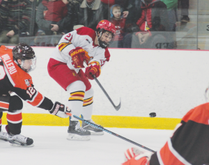 Senior forward Justin Buzzeo fires a shot at Bowling Green freshman goaltender Chris Nell during a 3-2 win over the then No. 8 team in the nation.