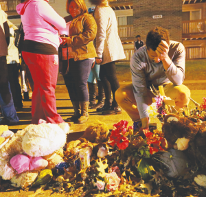 A Memorial of flowers, candles and gifts in the street where Michael Brown's body lay for hours uncovered in Ferguson, Missouri.
