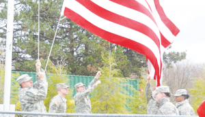 In this Torch File Photo, the Ferris ROTC students raise the flag at a football game.