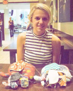 Ashley Modrzynski displays custom stuffed elephants that she crafts and donates to local  hospitals.